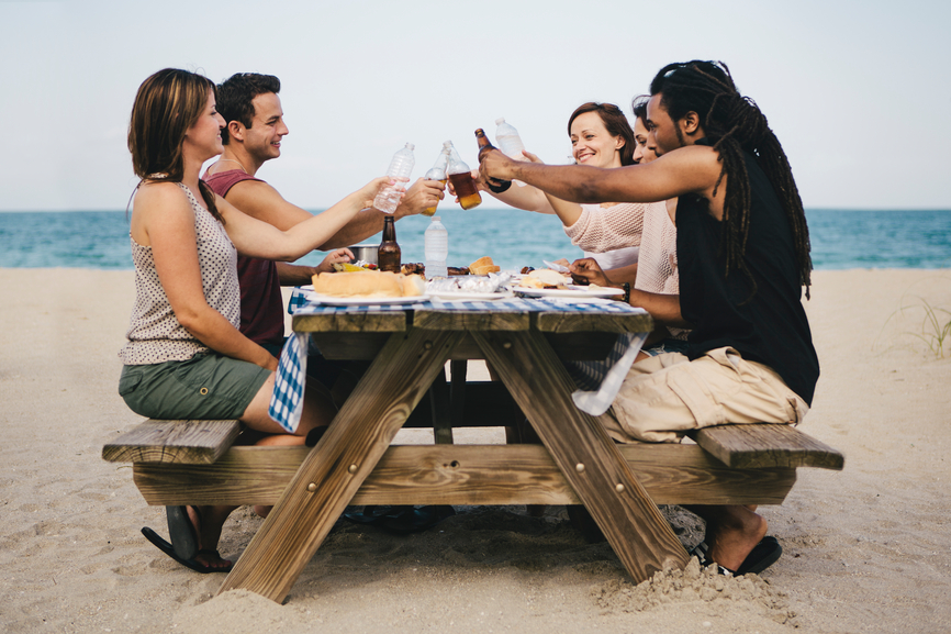 Friends Eating Picnic at the Beach