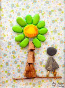 Piedras pintadas para manualidad de árbol con nombres